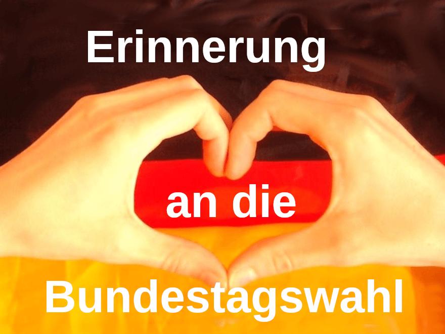 Deutschlandflagge mit Händen, die ein Herz bilden.Text - Erinnerung an die Bundestagswahl